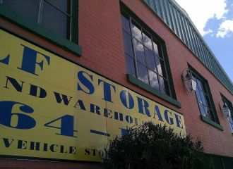 View of Maxwell Self Storage storefront and self storage sign