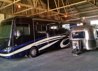 Recreational vehicle (RV) and travel trailer in warehouse storage