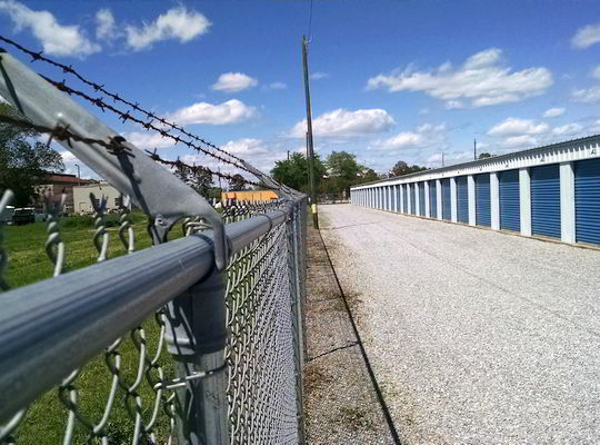 Mini storage surrounded by razor wire fencing