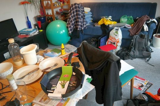 Cluttered room full of household items in need of a self storage unit