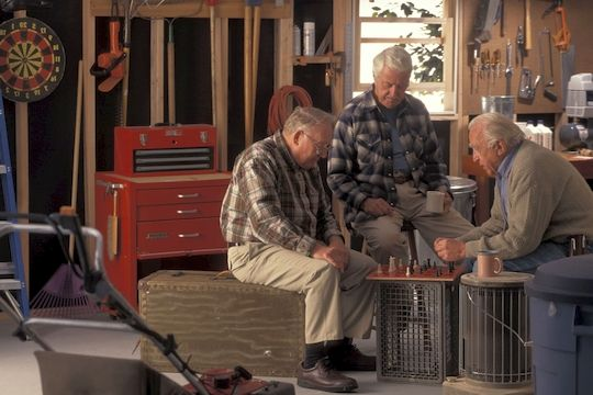 Old men playing chess in garage storage space