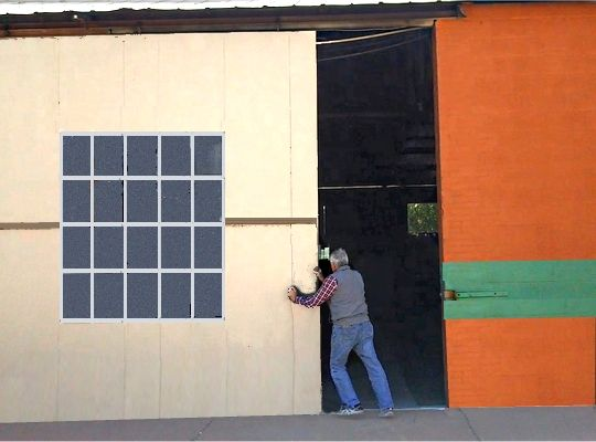 Warehouse Storage in Montgomery, AL - owner Ed Shoemake opens storage bay door