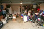 Messy, cluttered home garage in need of self storage services