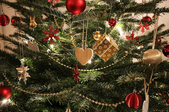 A variety of ornaments hanging on a Christmas tree