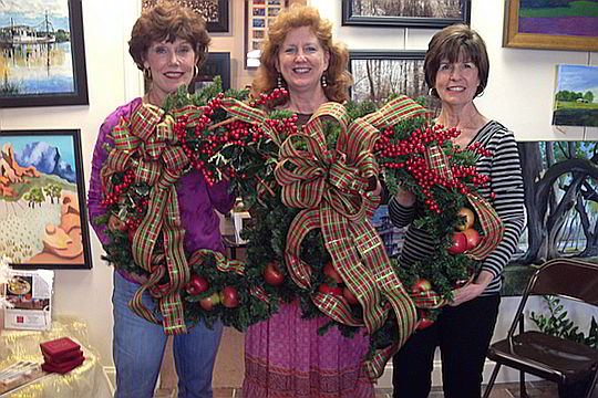 Ladies at SAC's Gallery showing off their handiwork at a wreath making class