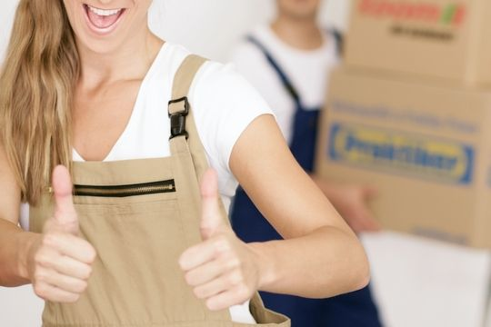 Happy man and woman saving money by performing DIY move and renting storage space